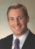 Headshot of Dr. Harkins in a dark suit and necktie