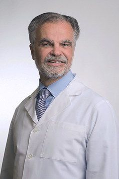 Dr. Petrosky in a white labcoat